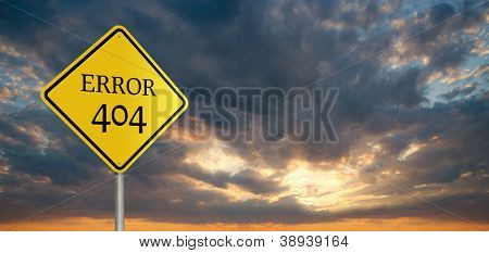 "Roadsign with message ""Error 404"" with stormy clouds and sunset in the background"
