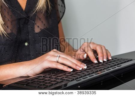 a woman with a computer keyboard. working in the office