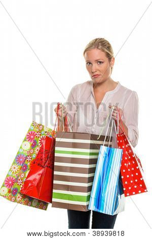 a young woman carrying shopping bags coming back from shopping. indebtedness, personal bankruptcy or commodities exchange