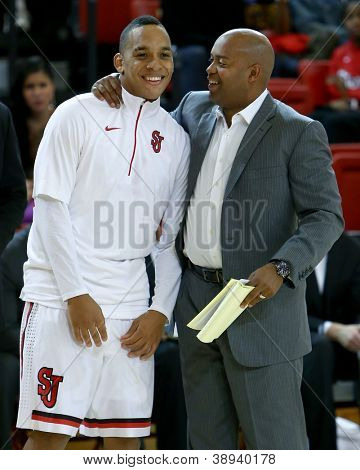 NEW YORK-NOV 3: St. John's Red Storm guard D'Angelo Harrison (L) and assistant coach Darrick Martin against the Sonoma State Seawolves at Carnesecca Arena on November 3, 2012 in Jamaica, New York.