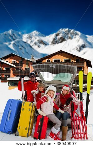 Winter vacations, ski, travel - family with baggage ready for the travel for ski vacations