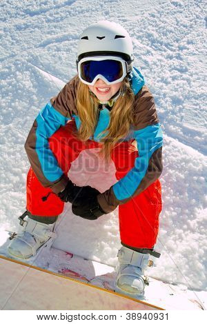 Snowboarding, winter fun, snow - young snowboarder girl