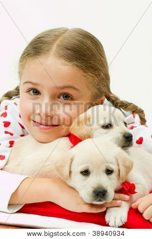 Best friends, happy childhood - lovely girl with cute puppies