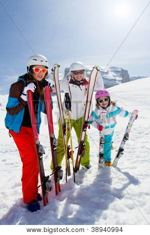 Skiing, winter, snow, sun and fun - female skiers enjoying winter vacations