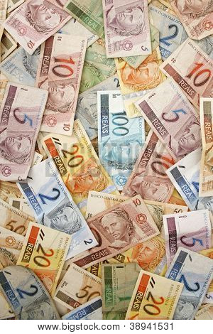 Reais (Real), Brazilian money background with a lot of bills.