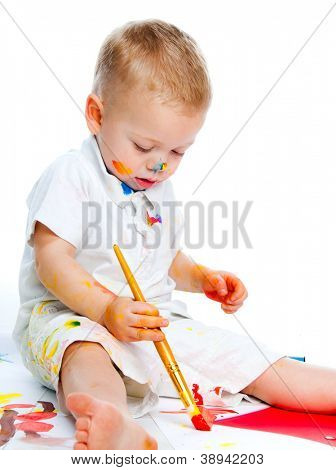 Cute boy with painbrush isolated on a white background