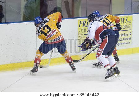Milan, Italy - November 15: L. Rigoni (13, Hc Asiago) Get The Puck  In Game Hc Milan Vs. Hc Asiago O