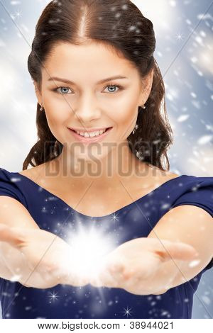 beautiful woman with magic on the palms of her hands