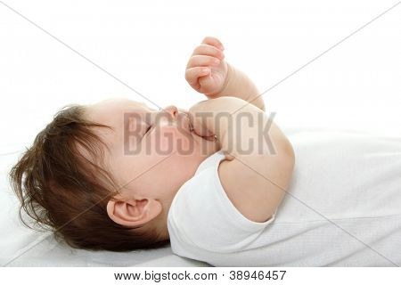 cute infant sleeping and sucking finger, beautiful kid's face closeup, studio shot