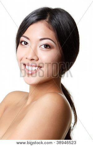 beauty woman portrait of young beautiful smiling woman with long black hair and clean skin over white