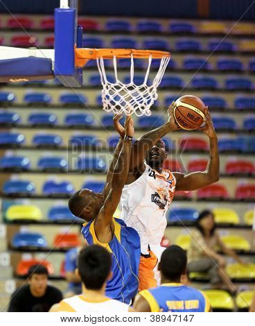 KUALA LUMPUR - OCTOBER 27: Firehorse's Anthony Johnson scores with a dunk in a Malaysia National Basketball League match against the Stallions on October 27, 2012 in Kuala Lumpur, Malaysia.