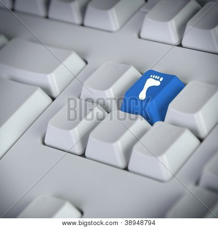 Computer keyboard with footprint symbol on the buton