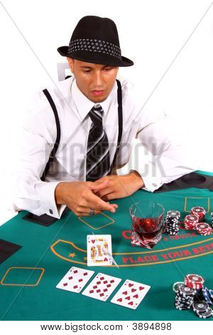 Young Poker Player Folding