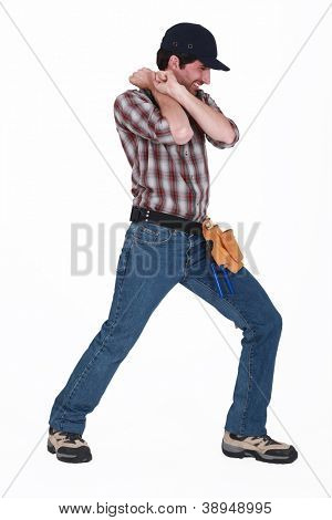Handyman pulling an invisible object