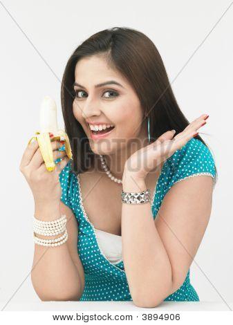Woman Eating A Yellow Banana