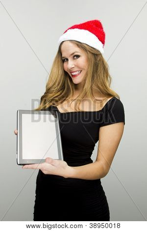 santa helper girl with tablet pc in hands, over neutral background