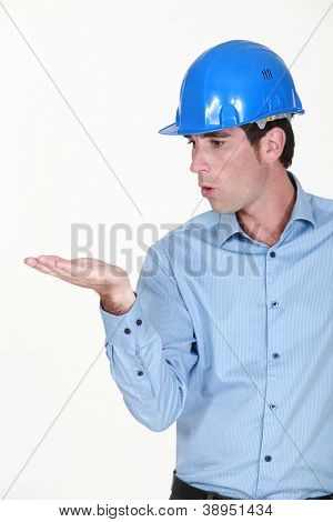 Engineer blowing an invisible object