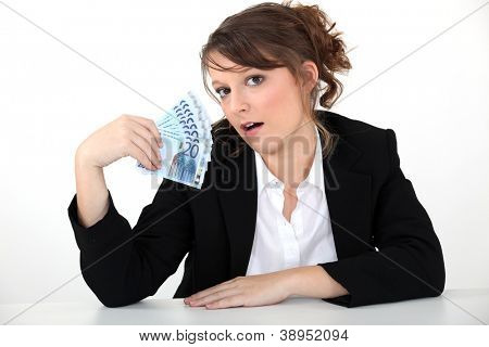 businesswoman holding bills