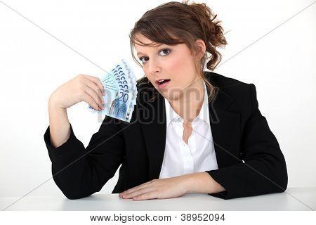 businesswoman holding bills
