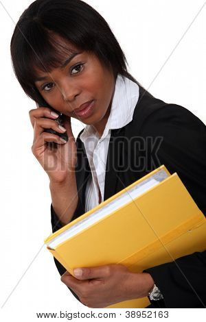 Female lawyer with documents and mobile