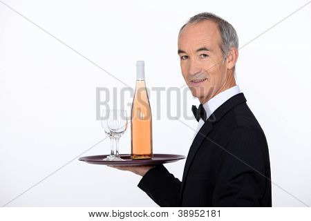 Waiter carrying wine on tray