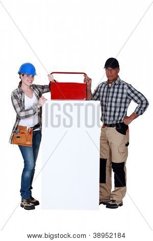 Workers with a toolbox and blank board