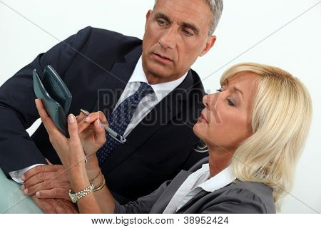 middleaged businessman with female counterpart