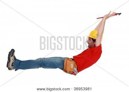 Tradesman jumping in the air