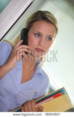 Office clerk answering the telephone