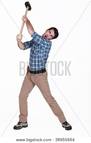 Man using sledge-hammer