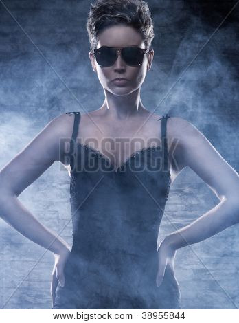 Police styled photo of young sexy woman over dark background