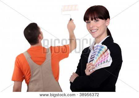 Woman holding color samples