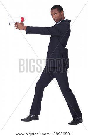 Man holding loud speaker