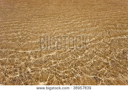 Water Above The Golden Sand