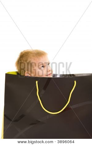 Cute Child Playing With A Shopping Bag
