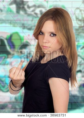 Attractive aggressive woman making an insulting gesture