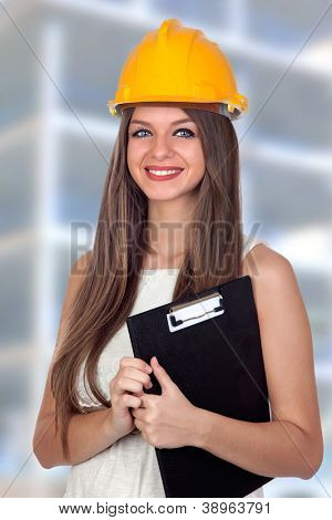 Attractive architect with blue eyes and yellow helmet at work