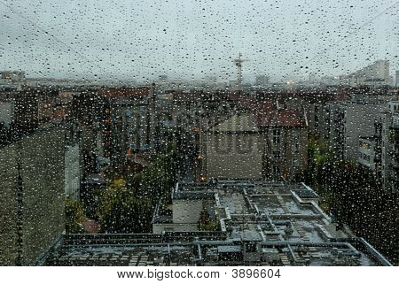 Rain Drops On A Window With City Landscape