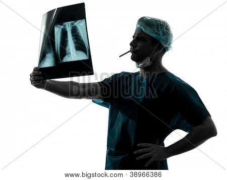 one caucasian man surgeon smoking medical worker silhouette isolated on white background