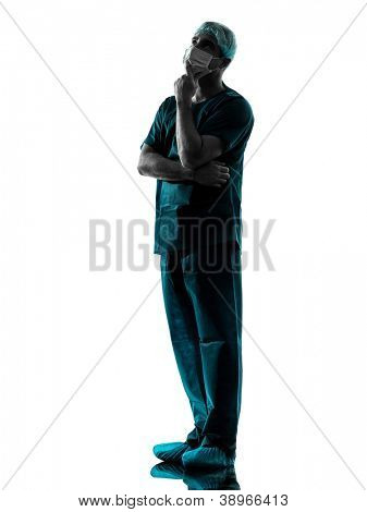 one caucasian man doctor surgeon thinking medical worker with face mask full length silhouette isolated on white background