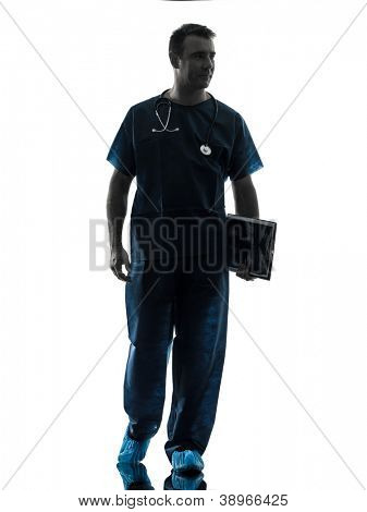 one caucasian man doctor surgeon medical worker walking full length silhouette isolated on white background