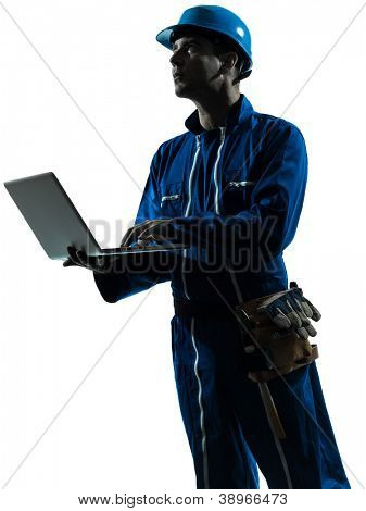 one caucasian man construction worker computing computer   silhouette portrait in studio on white background