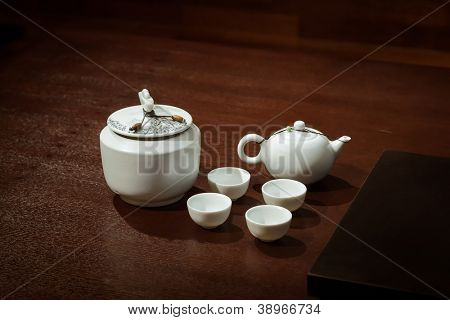 Tea  Set on a Wooden Table in a traditional asian tearoom, include  teapot and teacups and tea caddy.