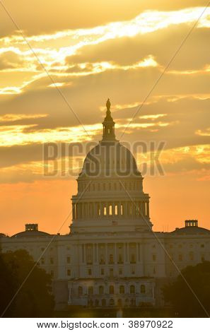 United States Capitol building silhouette at sunrise - Washington DC