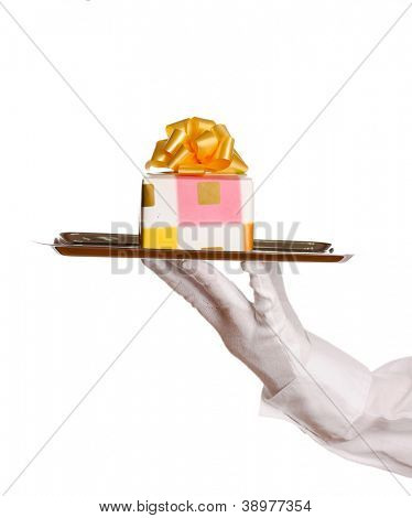 Hand in glove holding silver tray with giftbox isolated on white