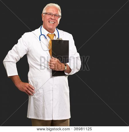 Portrait Of A Senior Doctor On Black Background