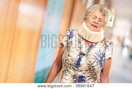 A Senior Woman Wearing A Neck brace, Indoor