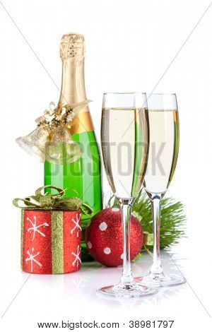 Champagne bottle, glasses and christmas decor. Isolated on white background