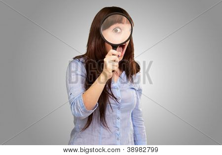 Woman Holding Magnifying Glass Isolated On Grey Background