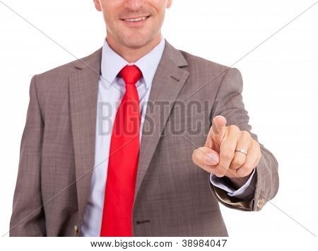 cutout of a business man touching an imaginary screen or button